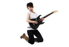 Rockstar. Asian female rockstar jumping in air Royalty Free Stock Photos