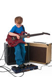Rockstar. Five year old rockstar playing his guitar Stock Photography