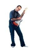 Rockstar. A young rockstar isolated on a white background Royalty Free Stock Photography