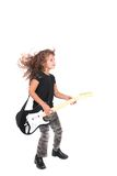 Rockstar child girl. A young female child playing guitar like a rockstar over white Royalty Free Stock Photography