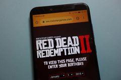 Rockstar Games presents Red Dead Redemption II game on their website displayed on smartphone. KONSKIE, POLAND - November 10, 2018: Rockstar Games presents Red royalty free stock images