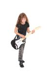 Rockstar girl child. A young female child playing guitar like a rockstar over white Stock Photography