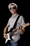 Rockstar with glasses holding a guitar Royalty Free Stock Photos