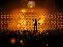 Rockstar with guitar and microphone on stage with wall speakers Royalty Free Stock Photo