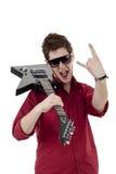 Rockstar mit Gitarre und Sonnenbrillen Stockbild