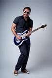 Rockstar playing solo. On guitar Stock Photo