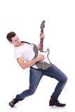 Rockstar playing solo. On guitar on white background Royalty Free Stock Photos