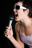Rockstar Singer. Pretty beautiful brunette rockstar singer Stock Photo