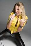 Rockstar Singer. Beautiful rockstar singer holding microphone Stock Photography