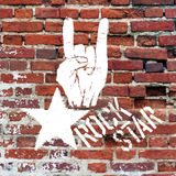 Rockstar symbol with sign of the horns gesture Royalty Free Stock Photos