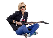 Rockstarl playing an electric guitar on her knees Royalty Free Stock Images