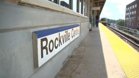 The Rockville Centre train leaving. Whip pan of the Rockville Centre train leaving the station stock video footage
