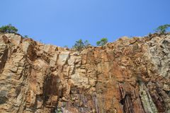 Rocky. Cliff    with  unique  shape  and   blue  sky Royalty Free Stock Photos