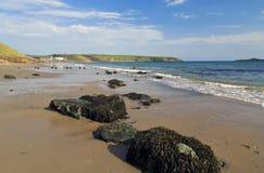 Rocky Aberdaron Beach and headland across the bay Stock Image