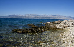 Rocky Adriatic coastline. Scenic view of rocky shoreline of Adriatic ocean, summer scene Stock Photos