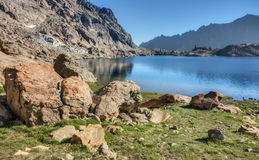 Rocky Alpine Lake on Sunny Summer Afternoon. The Rocky Shores of Lake Ingalls in the Cascade Mountains looks Refreshing on a Cloudless Summer Day Royalty Free Stock Images