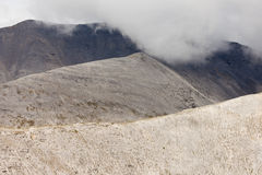 Rocky alpine mountain ridges low cloud cover Stock Images