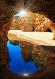 Rocky arch and sunshine on Algarve beach Royalty Free Stock Photography