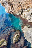 Rocky azure coastline and a beautiful clear water Stock Image