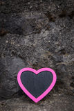 Rocky background and pink heart with copy space Stock Photo
