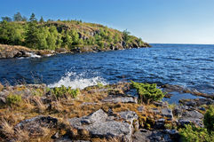 Rocky bank of the Ladoga lake. The high rocky coast of Ladoga lake covered with wood Stock Images