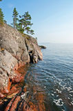 Rocky bank of the Ladoga lake. The rocky coast of Ladoga lake. Transparent water, unflawed sky royalty free stock photography