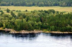 Rocky bank of the Yenisey river near the town of Sayanogorsk, Khakassia, Russia. royalty free stock photography