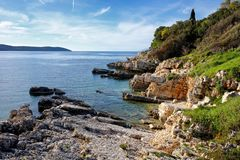 The rocky Bataria beach at Kassiopi with in Corfu, Greece.  royalty free stock photos