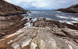 Rocky bay. Rocky coastline at Midfield in the Highlands of Scotland Royalty Free Stock Image