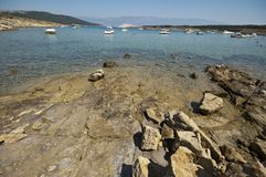 Rocky bay with boats Royalty Free Stock Image