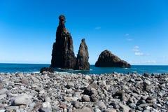 Rocky beach. Rock pinnacle at rocky beach stock photo
