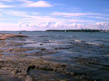 Rocky beach. Landscape - sea, beach, stones and sky Royalty Free Stock Images