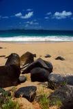 Rocky beach. Huge, volcanic rocks on the beach Stock Photos