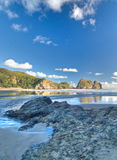 Rocky beach. At Piha, New Zealand. Very scenic Stock Image