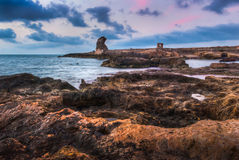 Rocky beach with ancient ruins Royalty Free Stock Photography