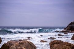 Free Rocky Beach And Beachcomber Royalty Free Stock Photo - 49947495