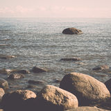 Rocky beach in the baltic sea. Vintage. Royalty Free Stock Photo