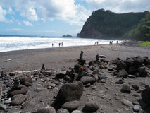 Rocky beach, black sand Hawaii Stock Photo
