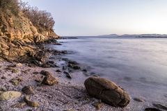 Rocky beach on black sea Stock Images