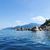 Rocky beach with blue sea from Thailand Royalty Free Stock Image