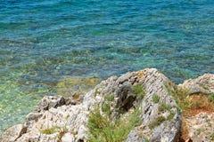 Rocky beach in Istria, Croatia. Rocky beach, bue transperent, sea and islands in Istria, Croatian coast royalty free stock photography