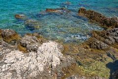 Rocky beach in Istria, Croatia. Rocky beach, bue transperent sea in Istria, Croatian coast royalty free stock photography