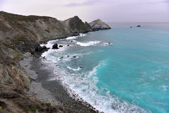 Rocky beach in california. Rocky ocean shore with turquoise water Stock Photo