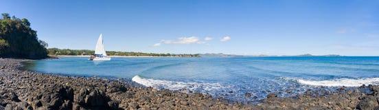 Rocky beach catamaran Stock Photos