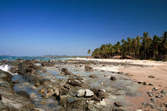 Rocky beach on a clear day, in Myanmar. Stock Image