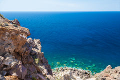 Rocky beach and clear turquoise water of the Aegean sea Stock Photo