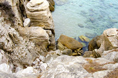 Rocky beach and clear turquoise water on Aegean sea Stock Images