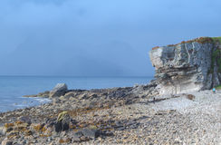 Rocky beach and cliff. The stony beach and cliff features of Elgol, Isle of Skye Stock Image
