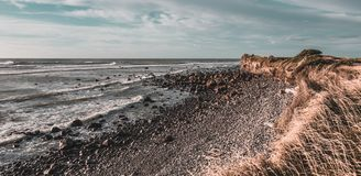 Rocky Beach with Cliff in the Evening Royalty Free Stock Photography