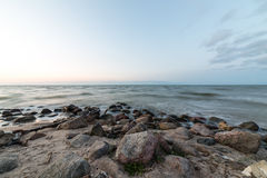 Rocky beach with clouds Royalty Free Stock Photo